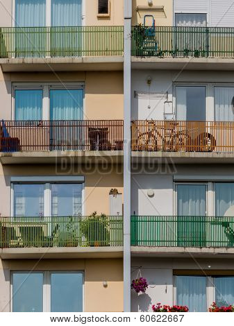 many balconies in a residential building for a number of parties in a city.