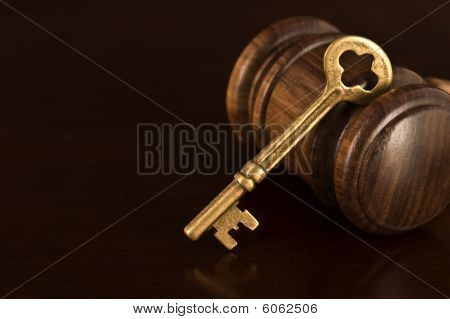 Wooden gavel and key