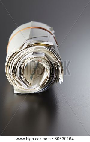 rolled expense receipt on the gray background