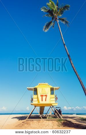 Yellow life guard tower on tropical beach