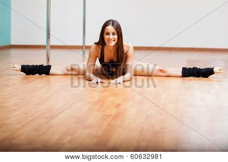 Pretty pole dancer doing a split