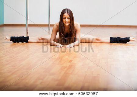 Beautiful pole dancer doing a split
