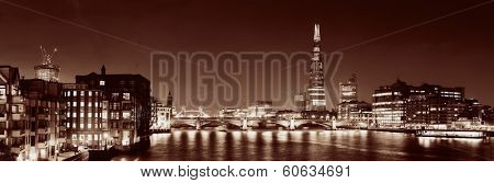 Southwark Bridge and London skyline at night.