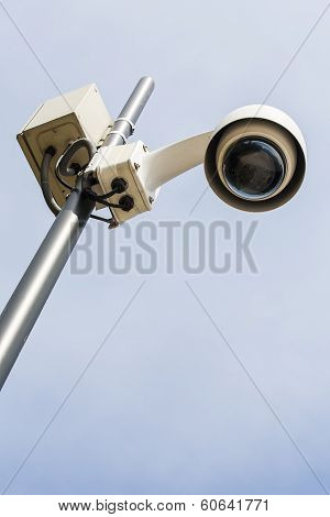 Modern security camera on a pole.
