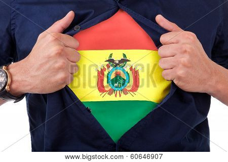 Young Sport Fan Opening His Shirt And Showing The Flag His Country Bolivia, Bolivian Flag