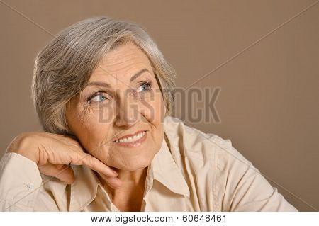 Beautiful Caucasian aged woman sitting