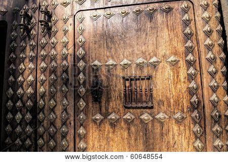 Sun Shining On The Wooden Door Of Rectorship Of The University Of Granada