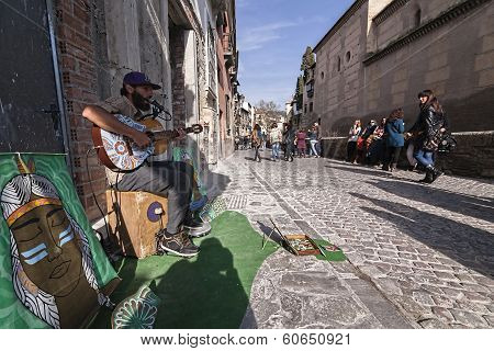 Musician Playing For A Few Coins In The Carrera Del Darro On A Sunday Afternoon, Granada, Spain