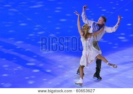 MOSCOW, RUSSIA - FEBRUARY 24, 2014: Tatiana Navka and Roman Kostomarov in action during Gala concert of Olympic champions in figure skating in Luzhniki