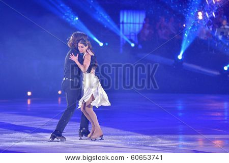 MOSCOW, RUSSIA - FEBRUARY 24, 2014: Peter Tchernyshev and Naomi Lang in action during Gala concert of Olympic champions in figure skating