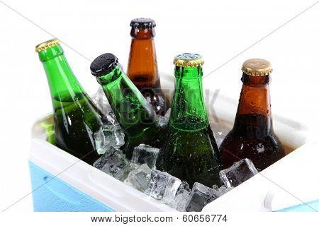 Ice chest full of drinks in bottles, isolated on white