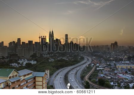 Kuala Lumpur Skyline With Highway At Sunset