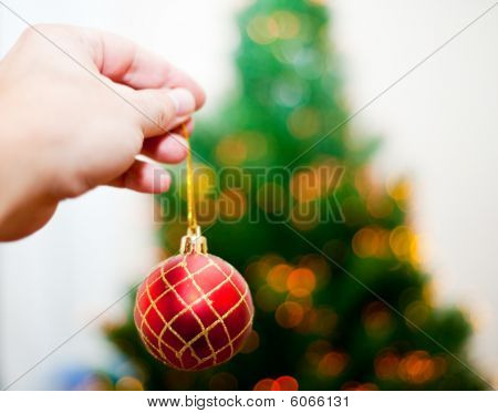 Hand Holding Christmas Ball