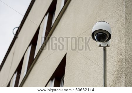 Security camera on building .
