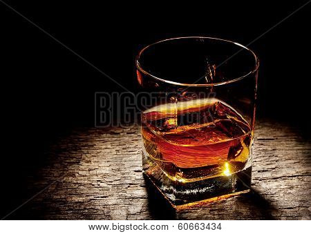 Glass Of Cognac In A Square Glass