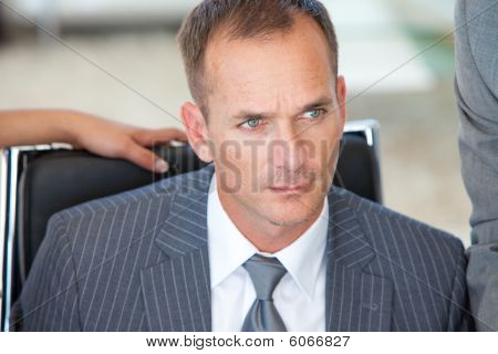 Portrait Of A Thoughtful Male Manager In Office