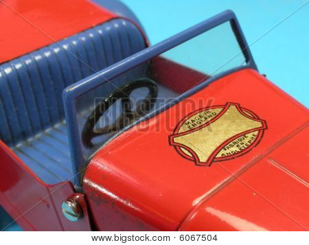Close Up Of Empty Seat In Old Vintage Metal Toy Car