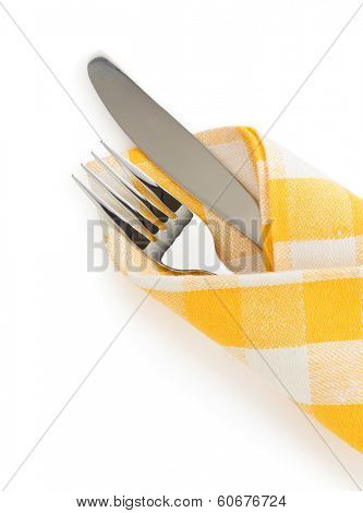knife and fork at napkin isolated on white background