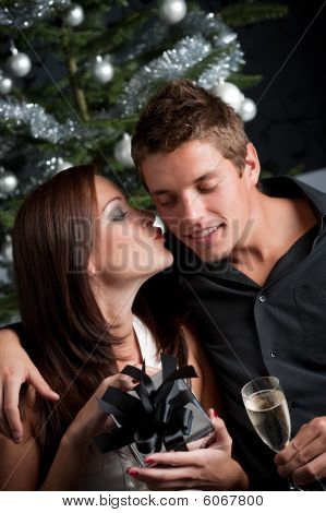 Young Sexy Couple In Front Of Christmas Tree