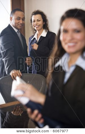 Multi-ethnic business people in boardroom