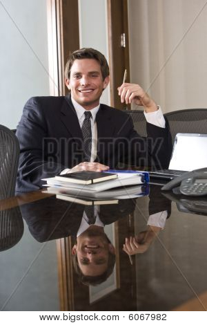 Young male business executive in boardroom