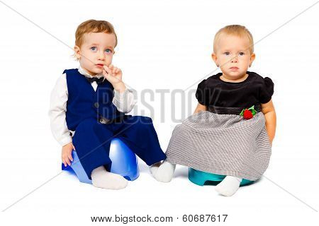 Trendy Kids Are Sitting On The Pot