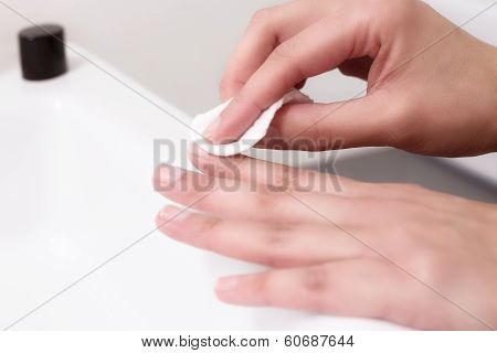 Woman Removing Nail Varnish With Acetone