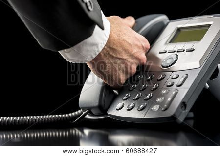 Businessman Making A Call On A Landline