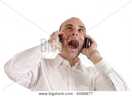 Businessman Screaming At Telephones