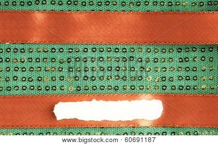 Green Sequine Background Texture Abstract Cloth Textile And Red Ribbon
