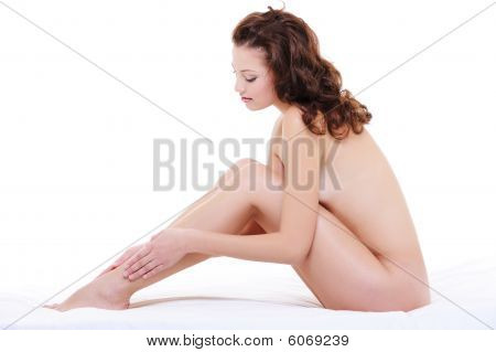 Woman With A Perfect Nude Body Stroking Her Long Legs