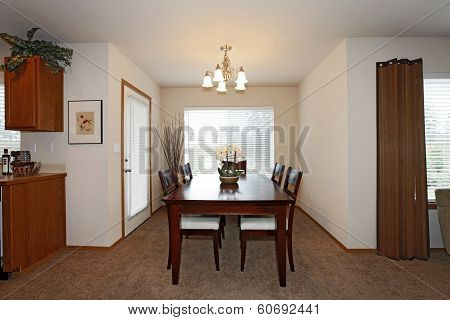 Bright Dining Room With Dark Brown Table Set