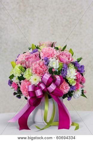 Flower Bouquet In White Ceramic Pot
