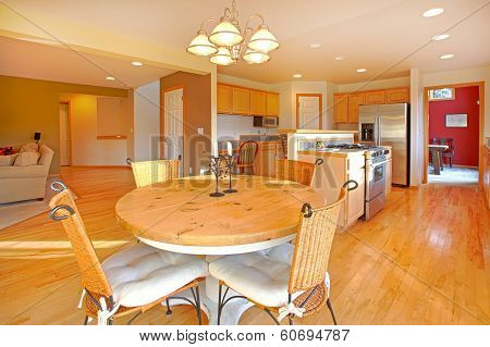 Bright Beautiful Kitchen With A Dining Table Set