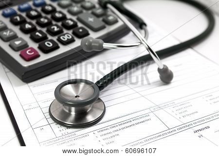 pen and stethoscope on blank Patient information