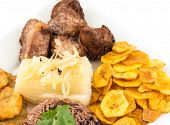 stock photo of cassava  - Deep fried pork yukka or cassava plus congri rice all with salty green banana fries - JPG
