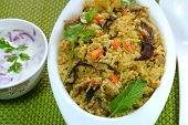 stock photo of raita  - Vegetable biriyani served with raita - JPG