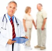 stock photo of medical doctors  - Smiling medical doctor with stethoscope and elderly couple - JPG
