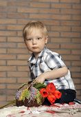 Young boy with a bouquet of flowers