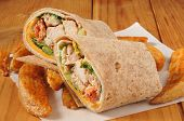 stock photo of sandwich wrap  - Chicken wrap sandwich with breaded potato logs - JPG