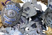foto of bobbies  - A large group of police shields and badges randomly piled - JPG
