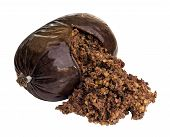 stock photo of haggis  - Haggis a traditional Scottish sausage made from sheep stomach and filled with sheeps liver lungs and heart oatmeal onion suet and seasoning - JPG