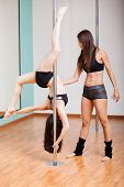 Pole fitness instructor in class