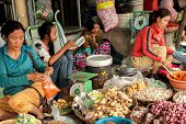 Khmer Women Selling Greengrocery And Spices At Market