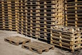 image of wooden pallet  - Wooden transport pallets in stacks ready for delivery - JPG