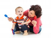 foto of child development  - Mother and baby boy having fun with musical toys - JPG