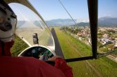 stock photo of ultralight  - Landing in an Ultralight aircraft at airport - JPG