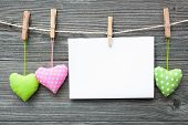 foto of clotheslines  - Message and hearts on the clothesline against wooden background - JPG