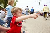 stock photo of parade  - Boy watching a parade - JPG