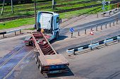 image of truck-stop  - Long Empty Truck Turns on the road - JPG